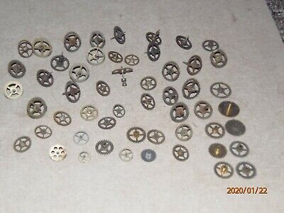 Vintage clock parts, job lot gearwheels, cogs, probably from Smiths clocks.