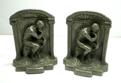 Pair of antique solid heavy cast figural bronze nude thinking man bookends