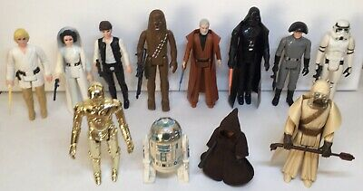 Vintage STAR WARS First 12 FIGURES with ORIGINAL WEAPONS & ACCESSORIES 1977