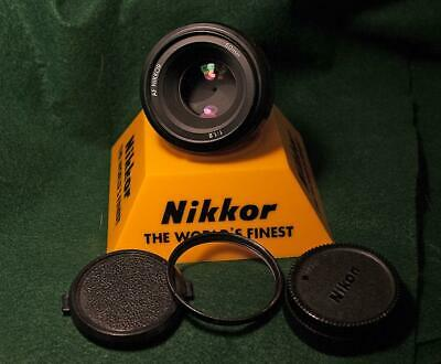 Nikon AF Nikkor 50mm  f1.8  w/Nikon L1B  filter and caps ...near mint