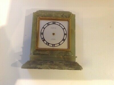 Looping Swiss made , 17 jewel lever, marble clock, project, repairs.