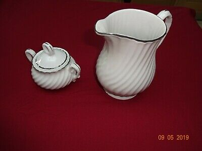 "White Swirled With Silver Rim Porcelain ""Harmony"" Milk Jug And Lidded Sugar Bowl"
