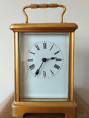 Antique Gold Gilded Carriage Clock Made In Switzerland in Excellent condition.
