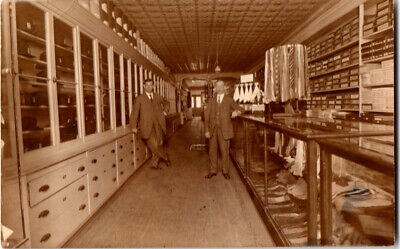S21.1974 RPPC Postcard Haberdashery with 2 Gents in Camden NY c 1910