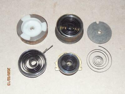 Vintage clock parts, job lot of mainsprings from old wall or mantel clocks.