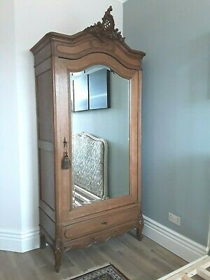 French Amoire - oak with single mirror door and carved details