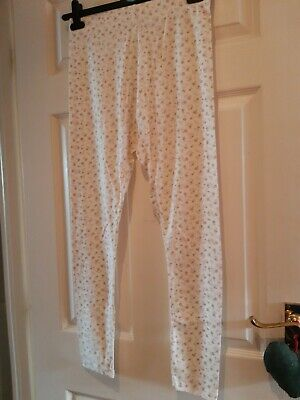 Cream Floral Leggings.  Size Small (10-12). New