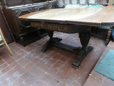 Antique Oak Dining table, dark wood, carved legs Extendable