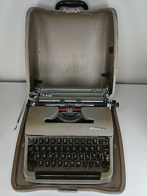 Vintage Olympia typewriter and case