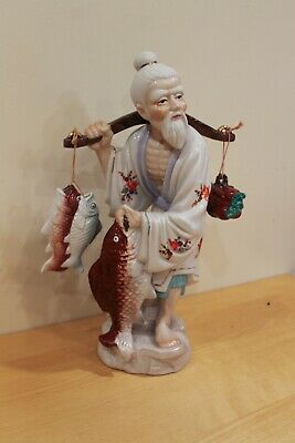 Asian Colored Porcelain Statue of Fisherman with Fish, metallic embellishmen