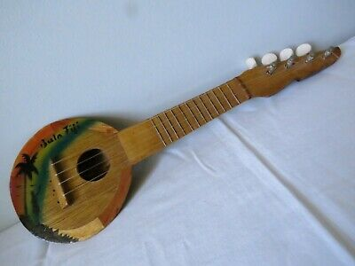 Traditional 4 string musical instrument from Fiji for display