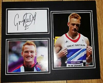 30x25cm HAND SIGNED MOUNTED DISPLAY GREG RUTHERFORD OLYMPIC LONG JUMP GOLD