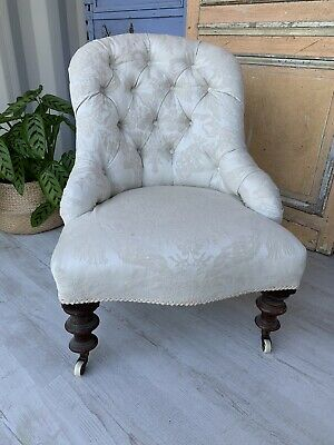 Antique Victorian Chair On Castors Upholstered In White Fabric