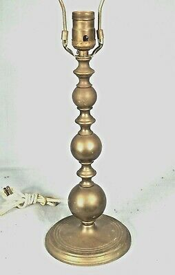 AN EARLY 20th CENTURY RING AND BALL TURNED CANDLESTICK LAMP