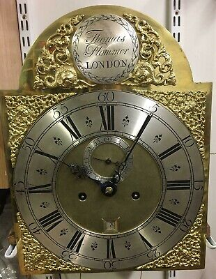 Grandfather antique clock movement with brass dial.
