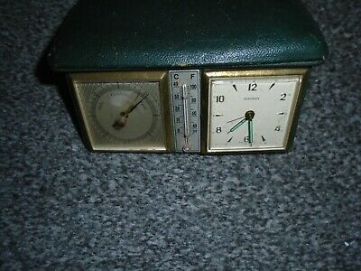 antique  marksman clock/barometer/ and thermometer,