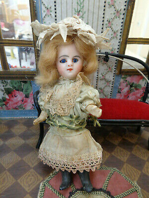 Antique doll adorable French Mignonette Mona Lisa closed mouth blue eyes c1890