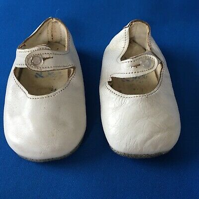 A pair of antique vintage baby shoes white leather original buttons by Baby Dee