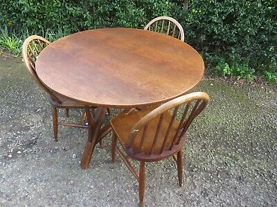 a Quirky Mid 20th-century circular oak dining table 3 chairs 20th century