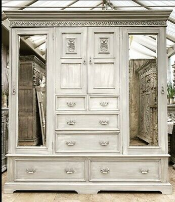 Triple Compactum Mirrored Carved Wardrobe