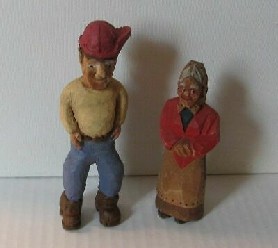 A pair of wooden Russian folk sculptures: An old peasant woman and a working man