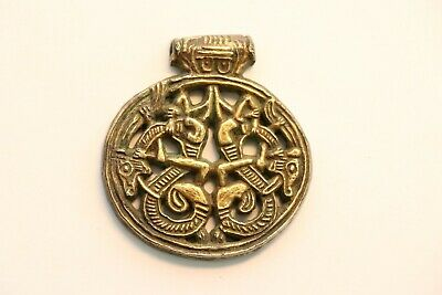 A gilt silver Viking pendant, 9th-10th century A.D.