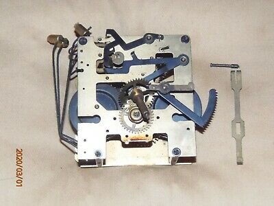 Vintage mantel or wall clock movement for parts or restoration.