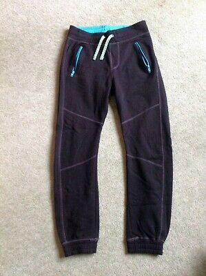 H&M tracksuit sports trousers, black with turquoise zips, age 11-12 years US