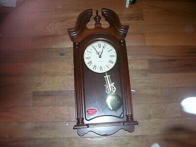 Used Dual Chimes Pendulum Quartz  number 625- 253 Howard Miller Wall Clock