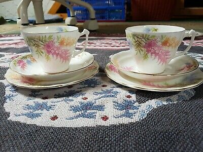 Two Vintage pink blue yellow flowers bone china teacups & saucers