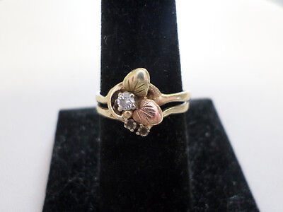 "14k yellow and rose gold ""diamond and leaves"" ring. Size 9"