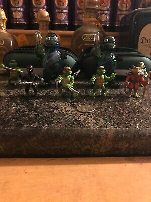 TEENAGE MUTANT NINJA TURTLES GLASS PIPES (x2) w/used cases and 6 Action Figures