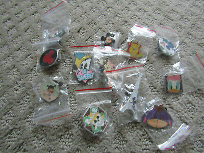 DISNEY PINS 12 DIFFERENT PINS MIXED  new