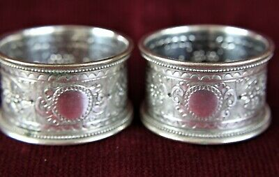 Two highly-decorated napkin rings. Not engraved.