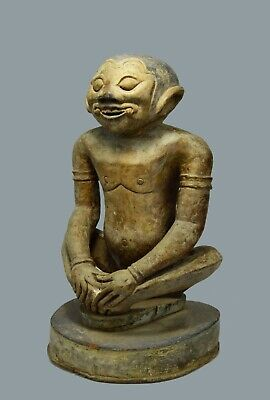 Old Sculpture of a Demon from a Balinese Temple