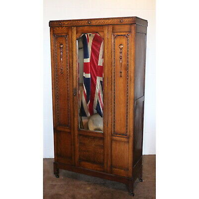 A 1930s Carved Oak Mirror Fronted Single Door Wardrobe, Part Suite