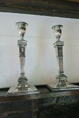 A pair of 19th Century Old Sheffield silver plate candlesticks