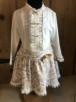 GIRLS SPANISH CREAM LONG SLEEVED SHIRT & FLORAL PRINT SKIRT OUTFIT..AGE 8 Years.