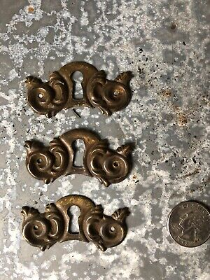 Vintage lot of 3 ornate stamped brass keyhole covers dresser, chest of drawers