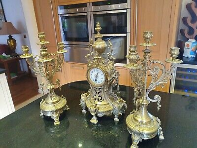 French Gilt Clock With Pair Of Matching Candelabra
