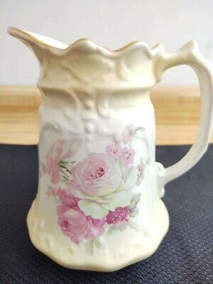 Vintage ceramic pitcher with rose decals and gold trim