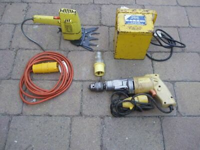 110v TRANSFORMER, DRILL, HEDGE CLIPPER, SPARE PLUG.