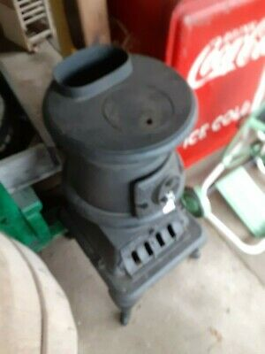vintage older small cast iron wood stove