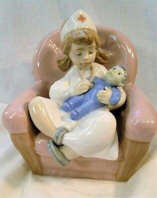LLADRO/Nao Pretty young Girl dressed as a Nurse treating her dolly