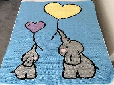Large handmade baby blanket. Mother and baby elephants with balloons.