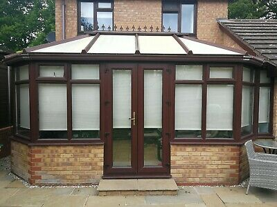 Conservatory used, Victorian style. Brown upvc