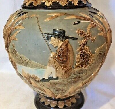 A Wilhelm Schiller 19th century Majolica Jug, decorated with an Angler, perfect