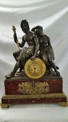 Period 1780-1820 FRENCH EMPIRE BRONZE AND RED MARBLE CLOCK