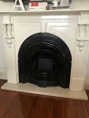 Mantel and cast iron fireplace
