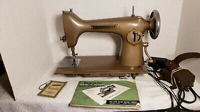 Vintage New Home All Metal Sewing Machine with Instruction Book And Accessories